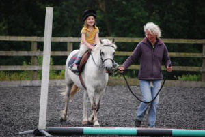 Child's horse riding lesson by Ruth Gardiner of the Enborne Equestrian Centre near Hamstead Marshall, Newbury